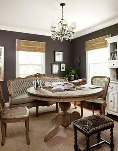 charcoal walls: settee up to dining table