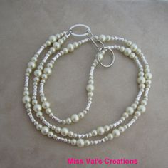 Ivory pearl lanyard badge ID holder by missvalscreations. Can also be used for keys, a cruise card or a transportation pass. #lanyard #pearl #etsy
