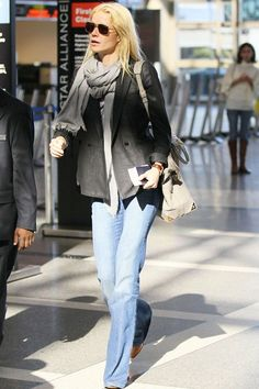 Gwyneth Paltrow looks every inch the regular flier in her relaxed denims and flat boots teamed with no-fuss hair and a roomy, easy-to-carry bag.