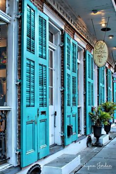 Turquoise Shutters Glistened Like, precious Stones, on Royal Street As, mesmerized Kings and queens Wandered The French Quarter, of New Orleans