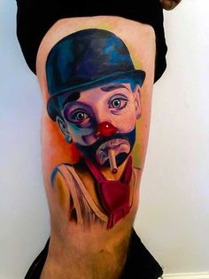 The portrait of a mime artist is featured in this color leg tattoo. Facial and body expression is the ultimate tool for a mime artist since he will have to convey a seamless storyline without the use of words. Thus being able to depict each minute expression in the face and body is crucial in order to achieve such a photo-realistic portrait tattoo.