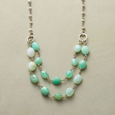 """PRELUDE NECKLACE--Cultured pearls linked with sterling silver are an apt prelude to the sea green hues of faceted chrysoprase ovals. Lobster clasp. Handmade. Exclusive. 18""""L."""