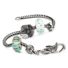 Meditate, it's time to move on and bring kindness wherever you go with the Green Faith of Lovers Bracelet. Birds of a Feather, small, Healing Heart, Lovers Faith, Wise Bamboo, Fan of Kindness, Heaven Crane lock and Sterling Silver bracelet make up the Green Faith of Lovers bracelet.
