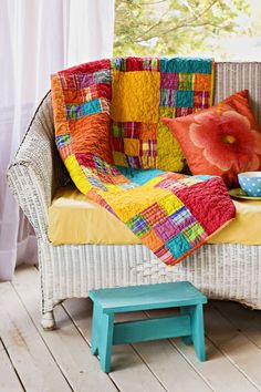 Each block of this sizzling, south-of-the-border 54-1/2-square throw uses  nine assorted stripe, plaid, and solid fabrics.