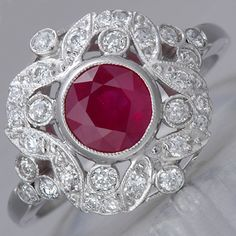 Art Deco Ruby Engagement Ring - I love the style of this ring. Beautiful detail around a deep red ruby.