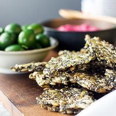 Healthy and moreish home made five seed crackers are a tasty snack by themselves or with your favourite dip, perfect to serve alongside drinks.