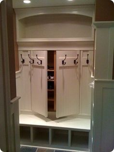 French door-style closet doors with hooks on the outside from - http://OrganizingMadeFun.com. This is exactly the idea I was looking for for my front entryway closet. Must show the hubby.