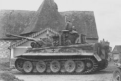 """Tiger """"131"""" from 1./schwere SS-Panzer-Abteilung 101, with SS-Untersturmführer Walther Hahn in the turret hatch, passes in front of the Notre..."""