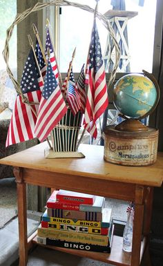 Flag display in flower basket. Vintage board games. Globe. Old tin. (Beyond The Picket Fence: 4th of July Decor)