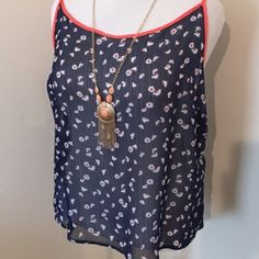 Racer back top Navy blue with white daisy print trimmed with tangerine adjustable straps ( sheer) BONGO Tops Tank Tops
