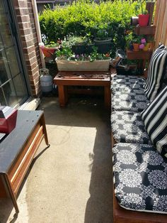 Turn a tiny patio into something beautiful and functional with a little time and work. Add a bench, potted plants and even a small fountain...now enjoy!
