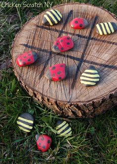 DIY Outdoor Tic Tac Toe Find a flat surface (a tree stump) and mark your grid. Use black river rocks for tokens. Paint on four versions of both patterns (plus one extra ladybug!) for a total of nine, and start playing!