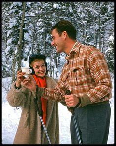Rita Hayworth and Errol Flynn having something to warm them up. In Sun Valley 1940