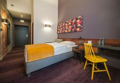 Functional colours. Bright contrast focal peice. Tobaco Hotel by EC5 Lodz Poland