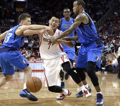 Houston Rockets' Jeremy Lin (7) is fouled by Dallas Mavericks' Gal Mekel (33) as he's also grabbed by Monta Ellis (11) while Samuel Dalembert watches in the second half of an NBA basketball game Friday, Nov. 1, 2013, in Houston. The Rockets won 113-105. (AP Photo/Pat Sullivan)