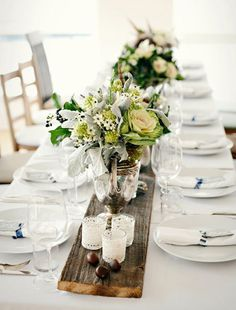 White Tablescape idea. Love the plank of wood against crisp white tablecloth and the use of silver tea pots