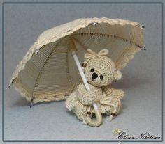 Miniature teddy bear with umbrella by Elena Nikitina