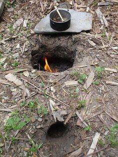 im totally going to try this.......make a hole in the ground,put the fire inside,put a flat rock on top,then cook