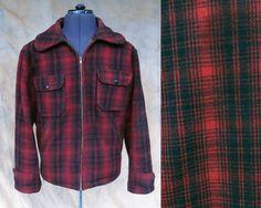 "Vintage Woolrich Buffalo Plaid Coat Size 42 // 1960s Woolrich Buffalo Plaid Coat, Men's 42 (Large) Iconic Red Buffalo Plaid with Zipper  Details Size: 42 (Large) Chest: 44"" Shoulders: 18"" Sleeve: 24.5"" Length: 26"""