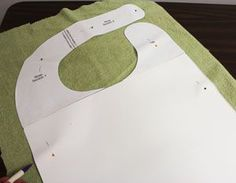 Free project instructions to make an adult bib with machine embroidery designs.  (Maybe make the bottom rounded)