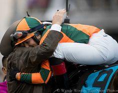 Jockey Rosie Napravnik gets a hug from trainer Larry Jones after winning the Grade I Kentucky Oaks aboard Believe You Can.