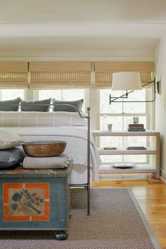 Completely fabulous - the width of this room called for a side table that was wider and then - rather than adding an expected table lamp, Linn used a large scale swing arm lamp mounted on the side wall (since there were windows on the traditional wall where the lamp would go) - totally unexpected in a very suble way - love!   eclectic bedroom by Linn Gresham Haute Decor