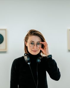Mia's wearing a pin (just below her headphones) modeled from the art of Hilma af Klint, hanging on the wall behind her. Hilma Af Klint, Headphones, Portraits, Photo And Video, Wall, Model, How To Wear, Photography, Color