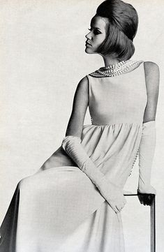 Veruschka in a white crèpe dress worn with a scarf of bogus pearls running down the back; dress by Junior Sophisticates, necklaces by Laguna, gloves by Viola Weinberger, photo by Penn, Vogue US, March 1963