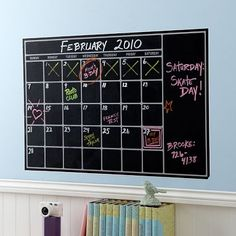 Chalk board calendar- might have to do this in the kitchen!  Such an easy way to keep up with everyone's activities!