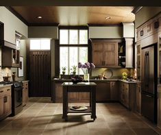 I like the high windows, the outside door, the color of the finish and Cherry inset kitchen cabinets by Decora Cabinetry