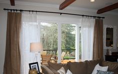 Big curtains over sliding glass doors?  (Not these specifically--just looking at the idea)