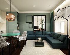 Petrol-green corner sofa, dark wooden floor and an ointment-like wall paint