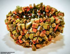 Unakite balances the emotional and spiritual bodies, and provides the gentle release of energetic blockages. It aids one to move on from outmoded beliefs from the past. Unakite is said to be good for the reproductive system, healthy pregnancies, and for the healthy development of unborn babies. It is also said to protect against electromagnetic pollution from computers or cell phones.