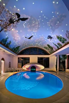 Fantasy indoor pool oasis with clamshell sculpture and mural painted barrel-vault ceiling