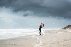 Stormy beach wedding Bride and Groom portrait. www.natalieheimphotography.com
