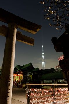 """Traditional old Shinto shrine with Tokyo's 2080-foot-high """"Skytree"""" in the background"""