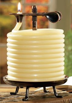 Cabela's: Candles by the Hour Made from pure beeswax Coils up from the burning plate to the clip Burns approximately 20 min. per inch exposed above the clip Extinguishes itself