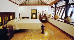 The restored Vengunad suite, part of the old palace, enjoys views of the kulam.