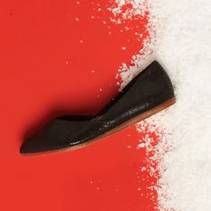 When it comes to holiday style, the snazzier the better. TOMS Black Crackled Leather Jutti Flats.