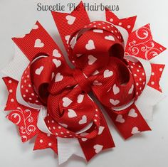 Red Valentine's Hair Bow Hairbow Deluxe Boutique Hairbows Funky Hairbow Red and White Valentine's Day Hair bow. $9.99, via Etsy.