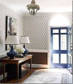 The accent paint on the screen door, the wallpaper and the double lamps - I love all of it!