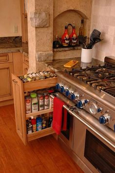 Remodeled kitchen with pullout base cabinet storage by Neal's Design Remodel.