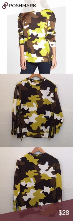 """Michael kors Zip Detail Camo Print Sweatshirt Vivid pops of neon ensure this camo print won't hide from anything. The comfy sweatshirt with a slightly oversized fit gets another fun touch from exposed zippers at the sides and cuffs. 27"""" length (size Medium). 93% polyester, 7% spandex. Dry clean or machine wash cold, tumble dry low. By MICHAEL Michael Kors; imported. MICHAEL Michael Kors Tops"""