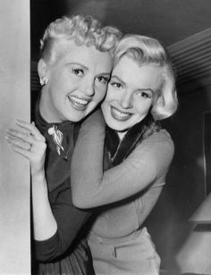 Marilyn and Betty Grable behind the scenes of How to Marry a Millionaire, 1953.
