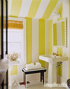 Designer Leslie Klotz used paint to create big, bold stripes in the bathroom of this Hamptons cottage: Apple Green and Decorator's White, both from Benjamin Moore. #stripes