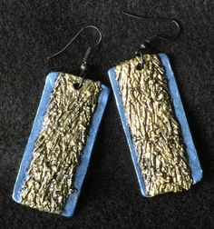 These boho inspired, handmade polymer clay dangle earrings with metallic champagne and blue hues, have a hand painted distressed, textured