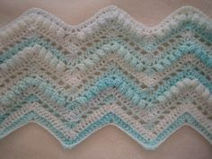 This is some of my own work which ended up as a bed throw. I was really pleased with the end result as I used a variegated coloured yarn. Free pattern