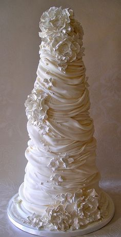 "Nice Icing (Lynette Horner ) made this whipped cream wedding cake for a wedding fair. It has six tiers (3"", 4"", 5"",6"",7"", & 8"") and is 26"" tall."
