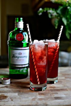 Pomegranate Gin & Tonic - Dry Gin, Tonic Water, Pomegranate Juice, Lime Wedges.