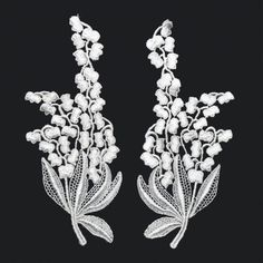 White guipure lace floral motifs, $5.00 per pair. http://www.alacraft.com.au/white-guipure-lace-floral-motifs-189.    Stitch or sew on. Ideal for decorating clothing or soft furnishings such as cushions, placemats, tablecloths and lampshades. Can also be used as a base embellishment for wedding dresses, costumes and dance wear.